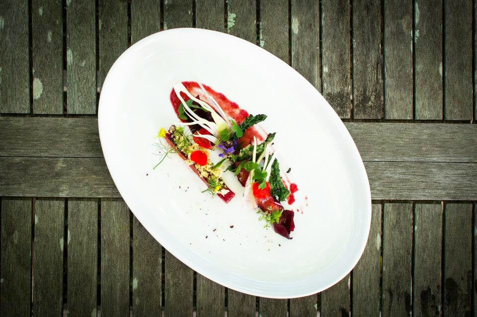 Freeze dried beetroot cured Salmon, plum puree, toasted kale
