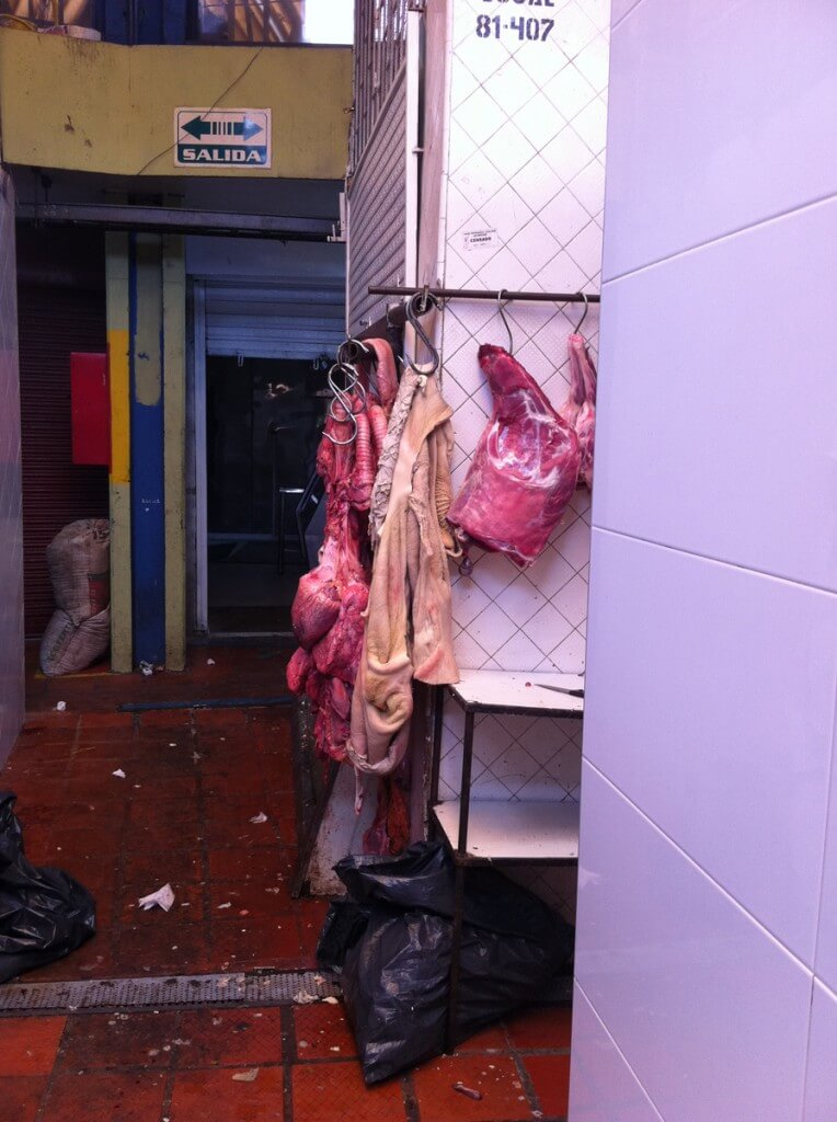 Pork Butcher at the Market