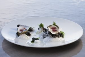 """Oysters with Mignonette GeleePresented in their """"Natural Setting,""""Squid Ink """"Rocks,"""" Verjus Sea Froth, Wakame by Chef Brad Kilgore. Photo by Battman."""