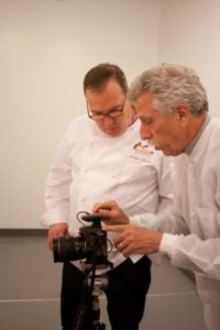 Chef Jacques Torres receives photography tips from Battman. Photo by Kara Chin.