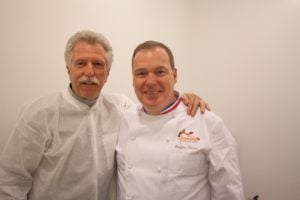 Chef Jacques Torres and Battman pose for a picture. Photo by Kara Chin.