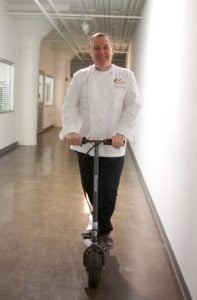 Chef Jacques Torres riding a scooter. Photo by Kara Chin.