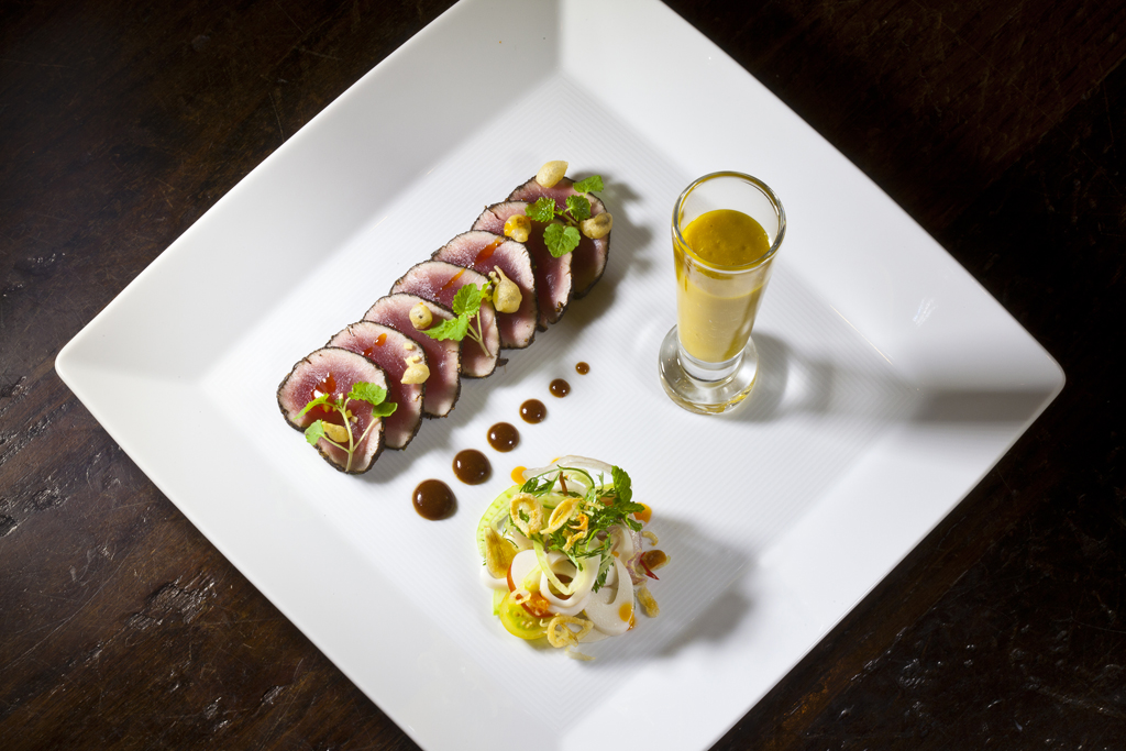 Tuna Carpaccio with a Tamarind Soy Sauce, Mango-Basil Gazpacho, and Palm Hearts Salad from Executive Chef Ashfer Biju