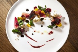 Roasted golden candy cane and red baby beets, goat cheese, hazelnuts, aged balsamic and beet vinaigrette