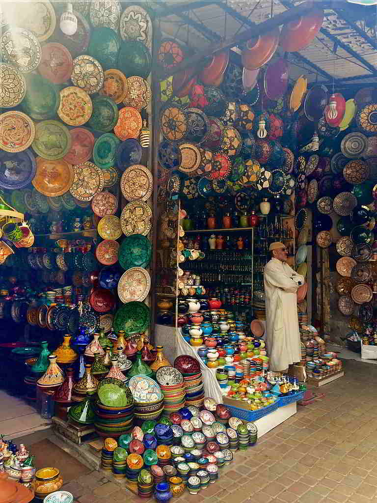 Image of pottery and shopkeeper.