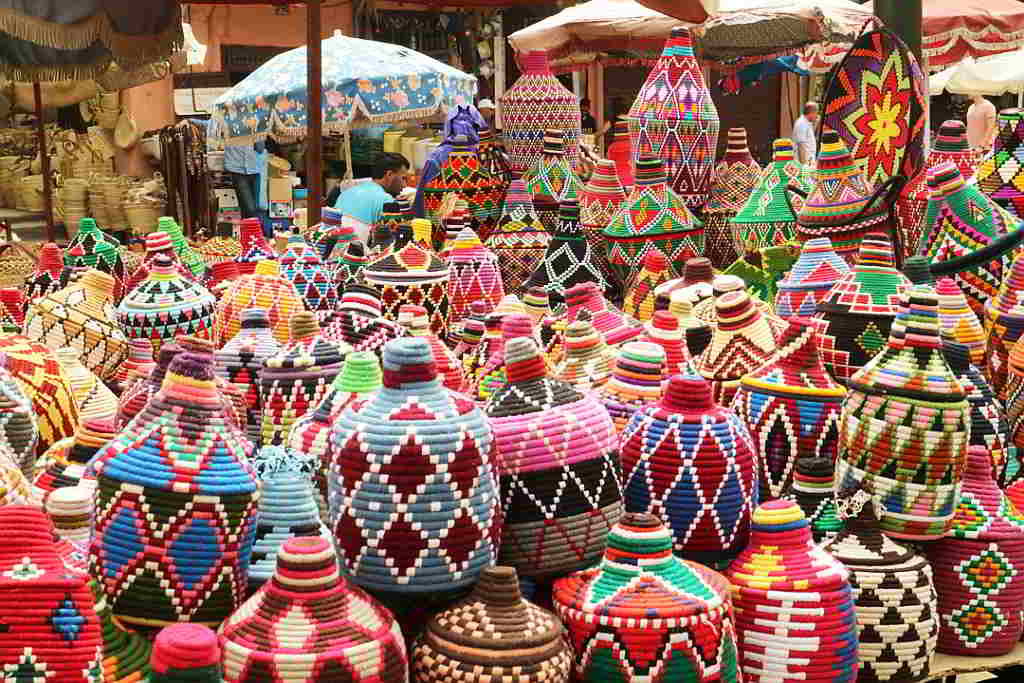 Image of baskets being sold at an outdoor market.