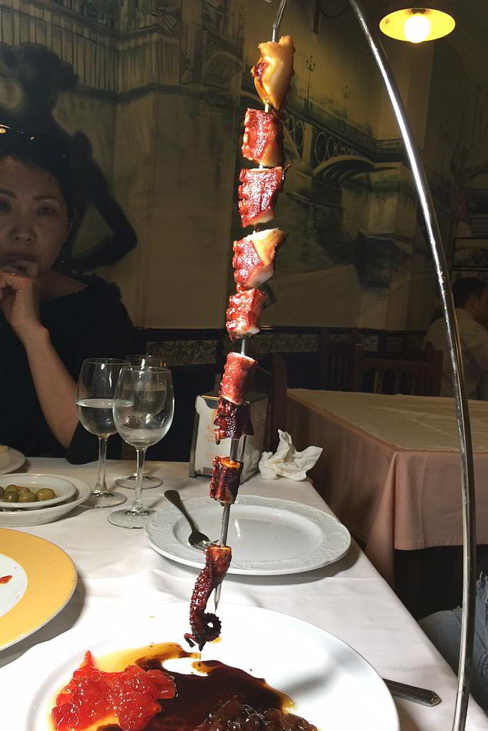 Evaluating a skewered tentacle. Photo by Battman. 2017