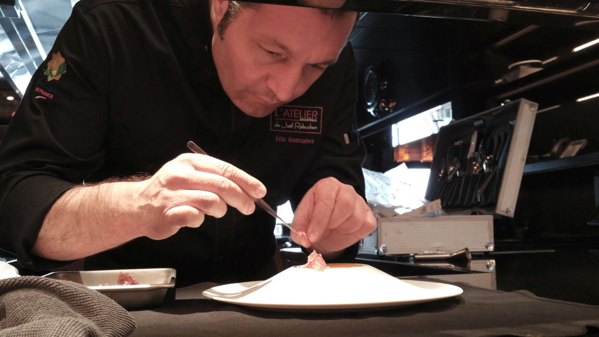 Chef Eric Gonzalez adding the final details to a dish.