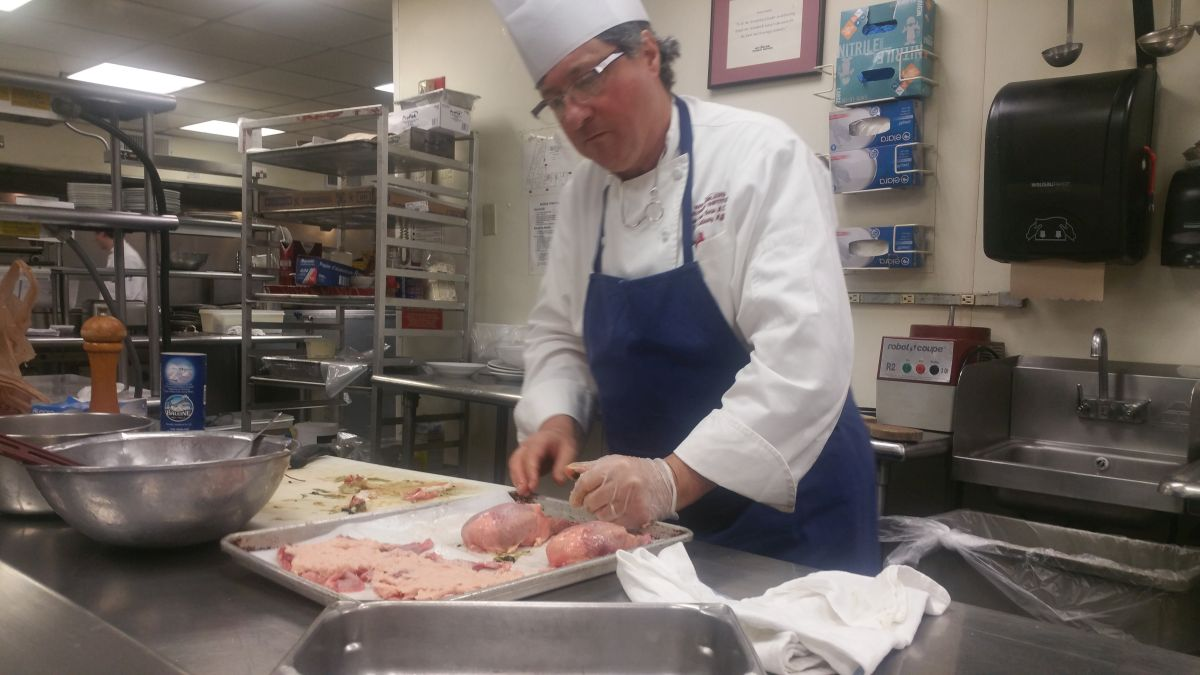 Chef Jean Luc Gerin at work in his kitchen.