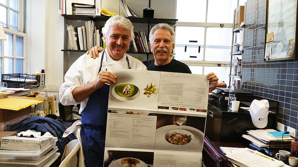 Battman and Chef Jean Louis Dumonet review the press sheets for Master Chefs of France cookbook.