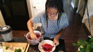 Haile Thomas preparing her Beet Pasta for photo shoot with Battman.